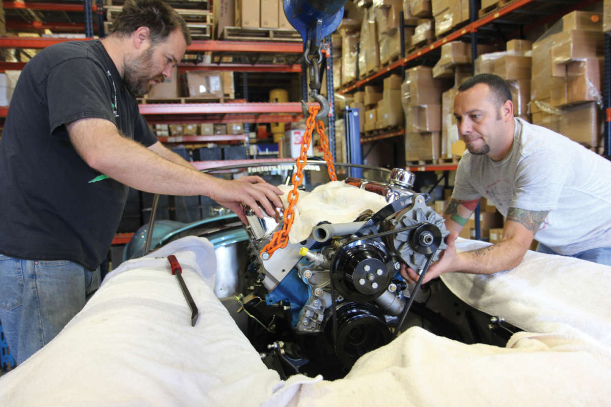 Blueprint engines joins factory five racing reincarnation magazine engines a1 easy does it as the blueprint gets lowered into the bay with the accessory pulleys malvernweather Images