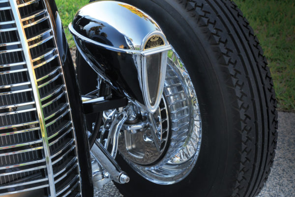 For a truly vintage style, the front suspension consists of a polished Pete & Jakes Hot Rod Parts drilled front axle with a transverse leaf spring, drop spindles, sea-leg (angled) shocks and hairpins.