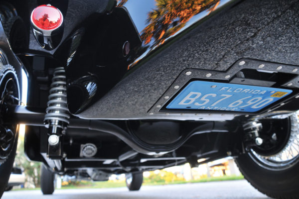 A retractable license plate folds into a pocket under the car when the ignition is off.