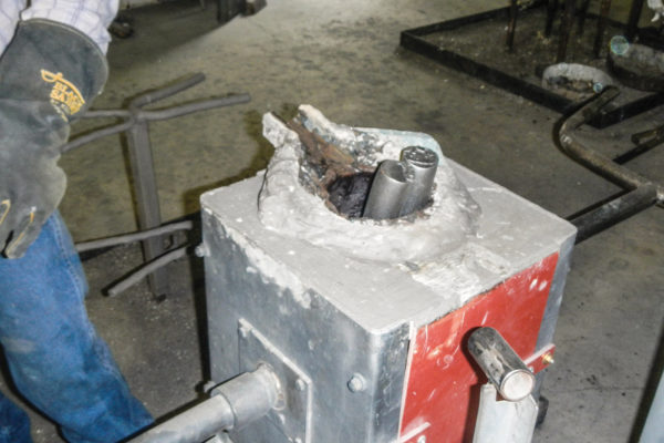 The metal ingots that will be used to make the actual pulleys are melted down.