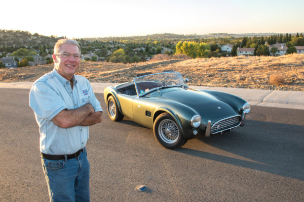 Owner Glenn Stasky can't help but smile over both of his Cobras.