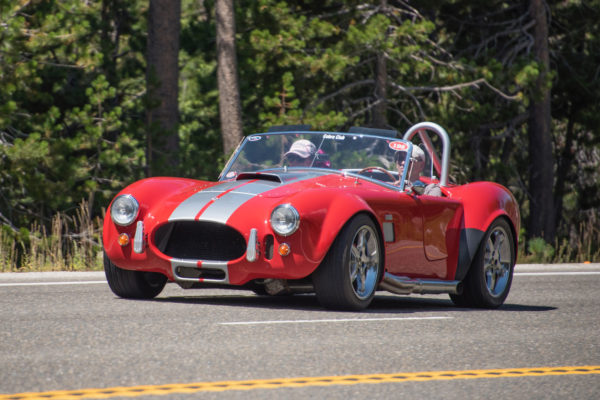 Russell Thompson's supercharged Factory Five roadster, one of the earlier models, has plenty of grunt to get up the grade through Echo Summit, a mountain pass with an elevation of 7300 feet, just west of Lake Tahoe.