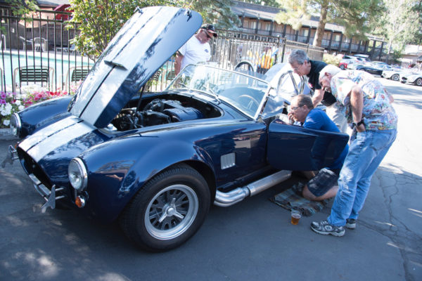 One club member's Cobra arrived unceremoniously on a tow truck's flat bed, and everyone lent a hand to get it running again.