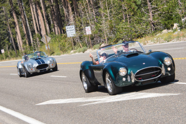 """It's all """"high fives"""" for club members who really enjoy the driving experience up to Lake Tahoe."""