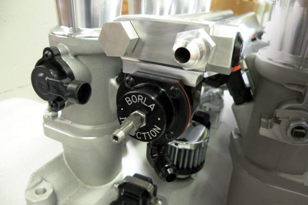 The fuel pressure regulator is now integrated into the fuel rail crossover at the rear and machined from 6061-T6 aluminum.