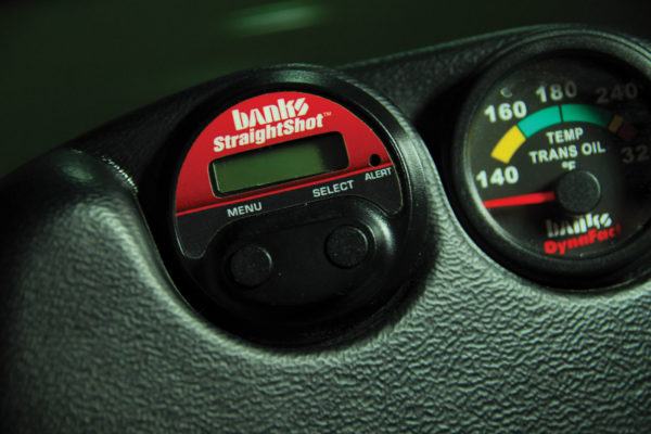 The wiring harness at the pump connects with the electronic gauge control, mounted in a housing on the dash. This unit also displays boost or throttle position sensor percentage, plus exhaust gas temp.