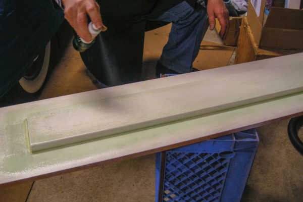 For this simple project, the mold consists of just two pine boards: One that is the actual size of the item we are making, which serves as the buck, and the second that serves as the supporting base for the mold. Note that although the sides of the buck may appear to be straight, or at right angles to the base, they are actually tapered inward from the base by a few degrees. This draft angle prevents the finished mold from getting trapped to the buck when the resin hardens and cures. Also, keep in mind that what you see (and feel) at each stage is what you will get when the finished product comes out of the mold. So sand the buck as smooth as possible. If you are using a soft, porous wood, such as the pine boards specified for this project, seal it with a commercial-grade wood sealer. To keep the wood from warping or bowing, clamp the base to the workbench.