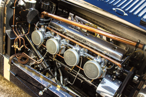 Copper tubing adorns the bay for the inline-eight engine.