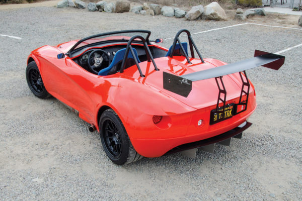 Hanging off the rear is a custom fabricated 3-D wing with a triangulated bracket support.