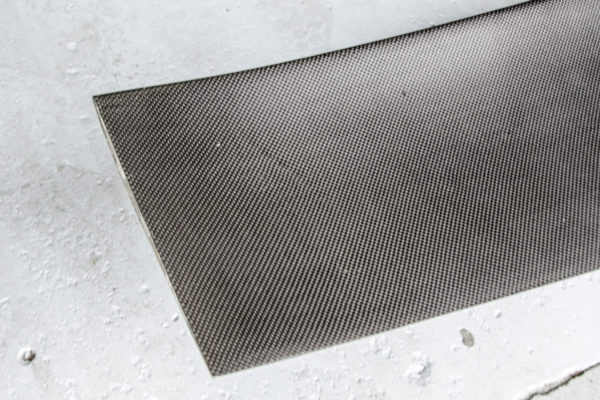 """The """"plain weave"""" type of carbon fiber is favored by companies such as Ducati and Ferrari. That's because the price starts to escalate when the manufacturing process goes from a basic wet layup to vacuum bagging, autoclaving and pre-impregnated carbon fiber."""