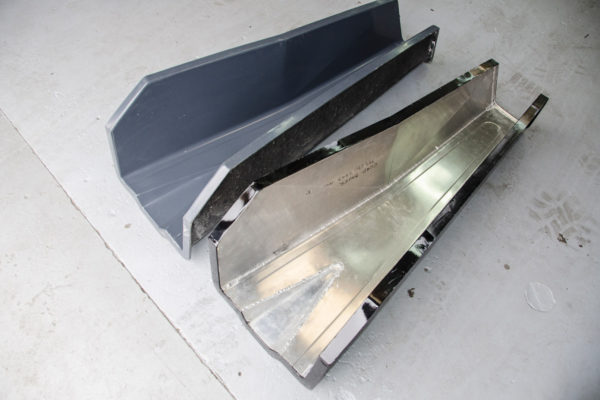 An aluminum buck was used to make the tunnel mold. The male side of the aluminum tool was painted and waxed and then was used to make the female mold. All future tunnels will be laid up in this female mold.