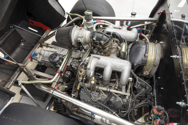 The Porsche engine started life as a 3.2-liter, but now displaces about 3.4 liters, delivering 290 horses to the 915 transmission. That's plenty of power for a car that weighs only 1,745 pounds.