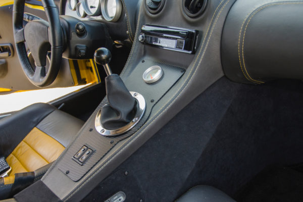 The shifter actuates a 1995 Porsche 911 Carrera II G50 6-speed transaxle with LSD.