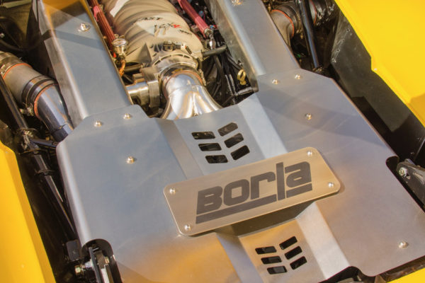 "Borla lent a hand in optimizing the output of the GM LS376/480 engine, which has custom ""over the valve cover"" headers. This setup is good for 444 horses at the rear wheels."