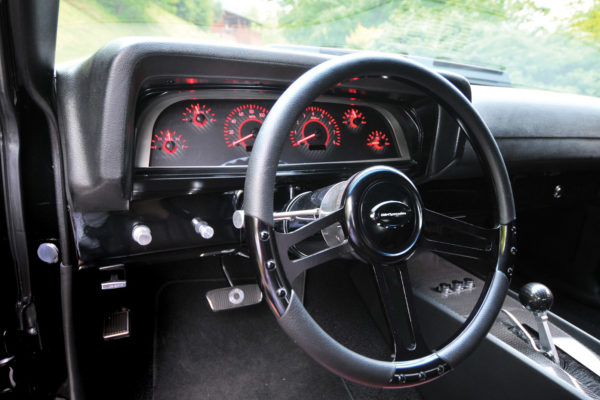 One of the highlights of the interior is the new Dakota Digital VHX Series gauge package that includes both analog and digital monitoring of vital engine functions. Originally designed for a 1963 Chevy pickup truck, the gauge package was adapted to fit the Torino dash with a piece of laser-cut stainless steel.