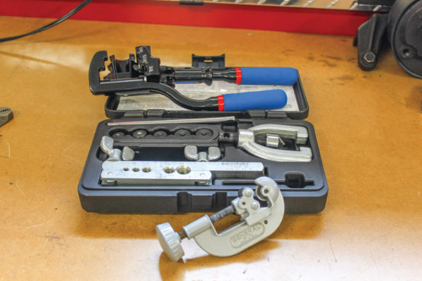 Handy tools for making brake lines include these items from Summit Racing; a tubing cutter, tubing bender (blue handles) and an OTC Double Flaring Tool Set.