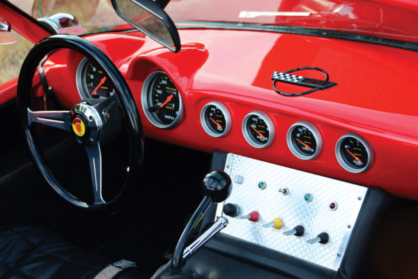 Gracing the dash are silver bezel AutoMeter gauges, along with toggle switches on a machine-turned console plate. The Dragon logo decals were custom made for the horn button and wheel hubs.