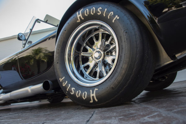 Trigo pin-drive wheels with knockoff spinners are wrapped with Hoosier race tires. The brakes are Brembo discs, 11 inches front and 9 inches in the rear.