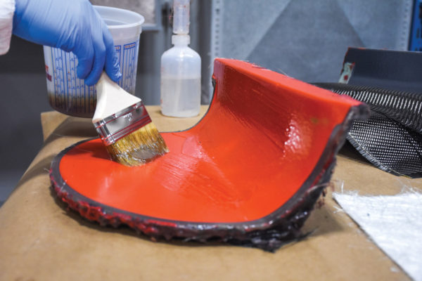 A throwaway brush is used to apply the catalyzed resin to the mold. If you're doing several parts, the brush can be stored in acetone to prevent it from getting hard but usually only for a day or less.