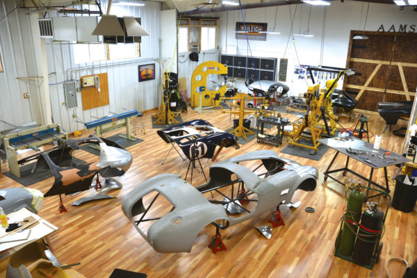 At the AAMS studio, a 427 Cobra is visible in foreground with several Cheetahs in the background serving as body bucks for new aluminum panels. Once Gerisch is satisfied with their shape, they'll be gas welded together into complete bodies.
