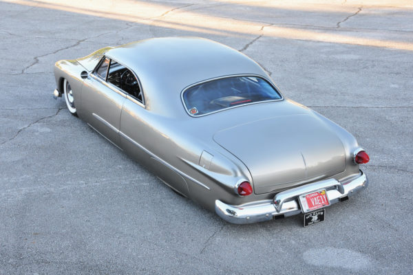 After shortening the roof 10 inches, Gary replaced the three-piece Vicky rear window with metal and glass from a coupe.