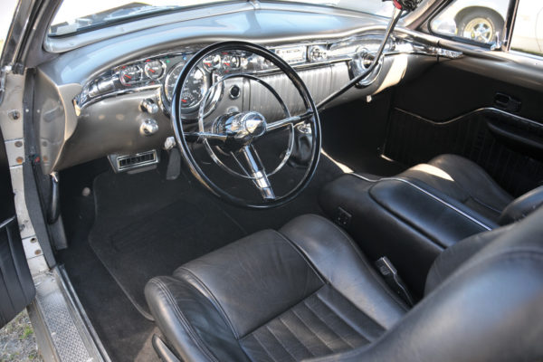 The modified '55 Olds dash has AutoMeter gauges and a cut-down rim from a '55 Chevy.