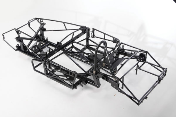 This is the base chassis of a Factory Five Roadster. It employs the traditional design of the two central 4-inch tubes, plus various crossmembers, supports and braces. While the design is stronger than the original Shelby, and is suitable for street use, some additional reinforcement would be welcome for high-performance and competition applications.