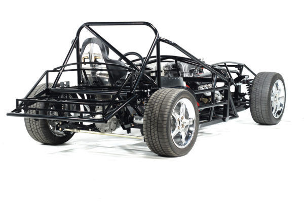 Note how the rolling chassis of the Factory Five Spec Racer has been beefed up. The passenger area is now fully surrounded by side structures, which tie the chassis into a solid box and give the passenger space full protection from side impact. The additional roll bar structure also provides additional chassis rigidity.