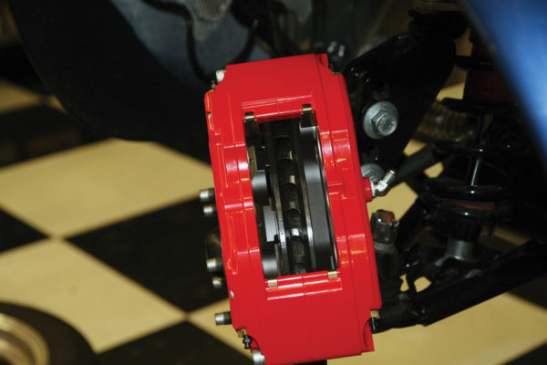 Once the caliper is on the bracket, with the largest pistons at the rotor exit end, make sure the rotor is centered in the caliper, and adjust if necessary by adding or subtracting shims. Once the caliper alignment is correct, remove and reinstall mounting bolts with red Loctite (torque to 40 ft-lbs).