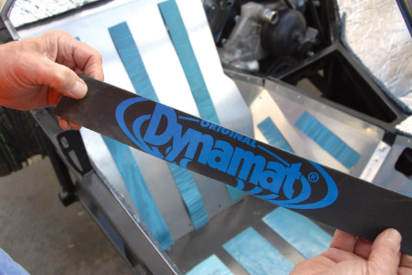 Dynamat is made of rubber and asphalt, which can reduce vibration by as much as 90 percent, according to QuietRide Solutions. This material has self-adhesive on one side, so you simply peel off the backing tape and press into position with a roller.