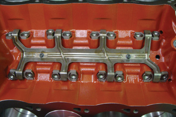 "Standard Ford hydraulic roller hold-downs (aka ""dogbones"") are used instead of a high-dollar link-bar setup."