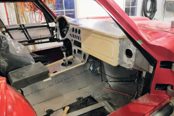 The glovebox-like structure conceals the Vintage Air climate control system.