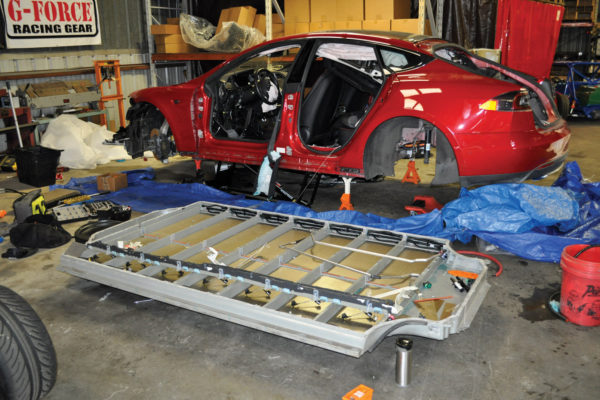 A slightly damaged Tesla Model S donated its pancake battery pack, which was then further disassembled into individual modules to fit them into the Exocet frame.