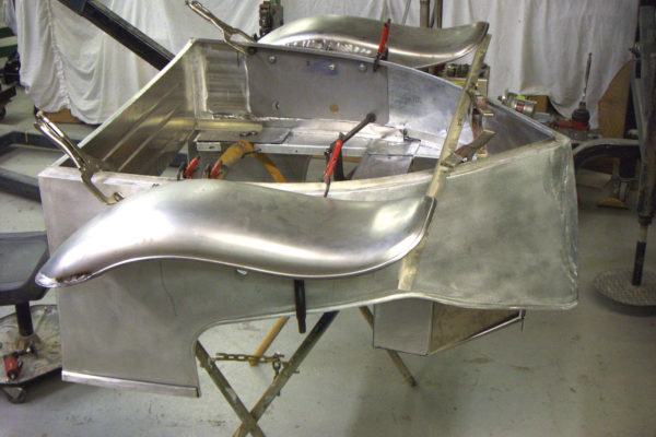 Rear fender mounts were fabricated that go through the side panels. To reinforce this area, steel plates where laminated on the back side of the aluminum panel.