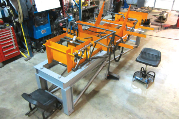 The tubular chassis is carefully welded up in a jig to ensure precision fitment.