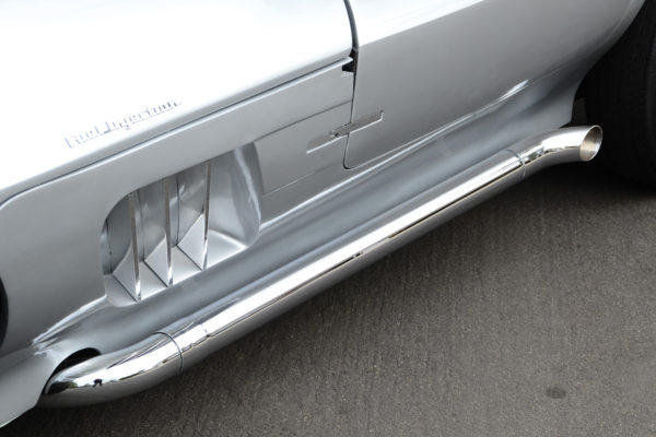 The Patriot side pipes originally had  shields over mufflers in the center section,  but Souza had them chromed instead.