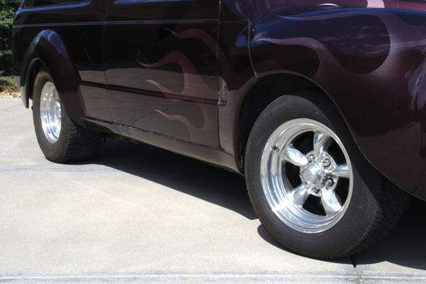 Here's a great wheel/tire fitment on our model. Note how both the front and rear wheels sit in the same place in relation to the outside of the wheel wells. Get it right there and the effect is subtle, but noticeable. When you see a car that looks a bit awkward or unbalanced in its stance, most of the time it's a poorly fitted wheel/tire combination.
