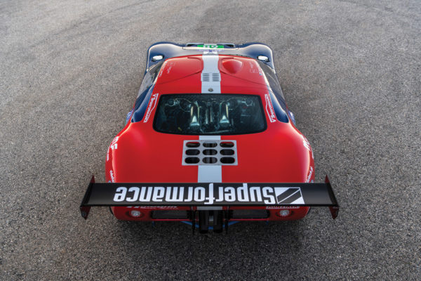 The classic lines of the MkI GT40 are clearly evident, but a wholly different engine is visible through the rear glass.