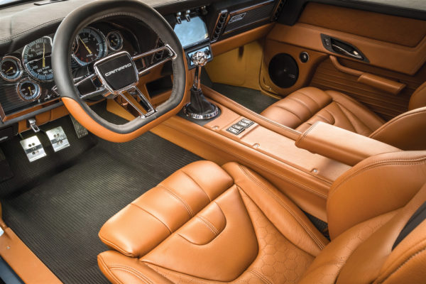 The interior is adorned with Ringbrothers trim pieces and custom leather upholstery, for a much more modern treatment.