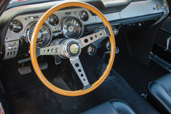 Also original is the wood-rim Shelby steering wheel, which required a pricey restoration.