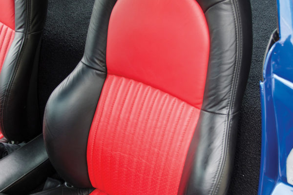 The seats are from a C5 Z06, and upholstered in black with red inserts and custom Grand Sport stitching.