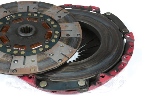 The scorched areas on this clutch disc show the effect of heavy acceleration. Even the best single disc-clutches eventually overheat and destroy themselves when exposed to excessive power. A dual-disc arrangement is always the 