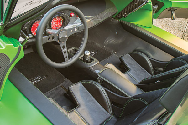 The cockpit is elemental in execution, using a lightweight carbon fiber dash panel and seats.