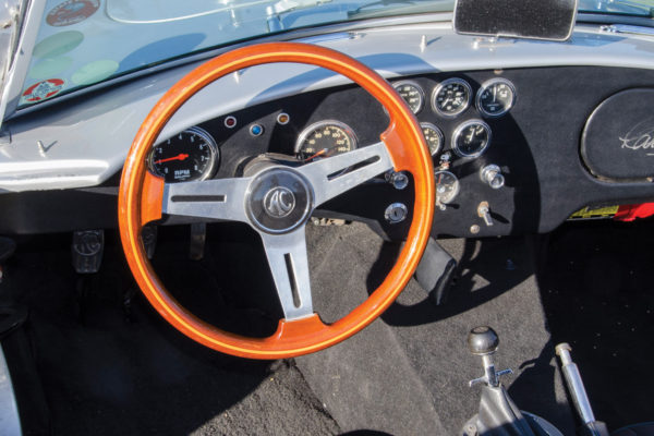 While the steering wheel is a traditional AC unit, the gauges are modern Autometer.