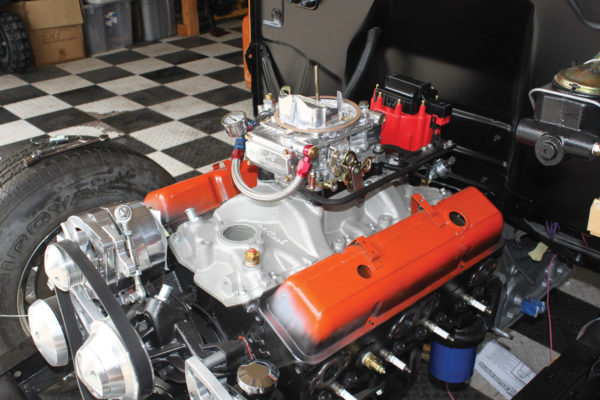 This is our starting point, a Chevy 350 ci small-block V8 with a Edelbrock manifold, 1-inch carb spacer, Holley 4160C four-barrel carburetor, HEI ignition and temperature sensors.
