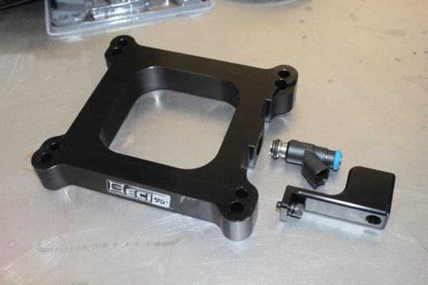When assembling the ECI injector plate, the components include the 1-inch plate, injector and fuel rail.