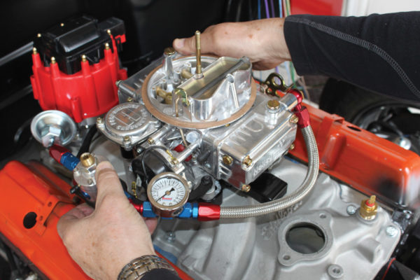 After adding a new gasket to the top of the plate, reinstall the carburetor.
