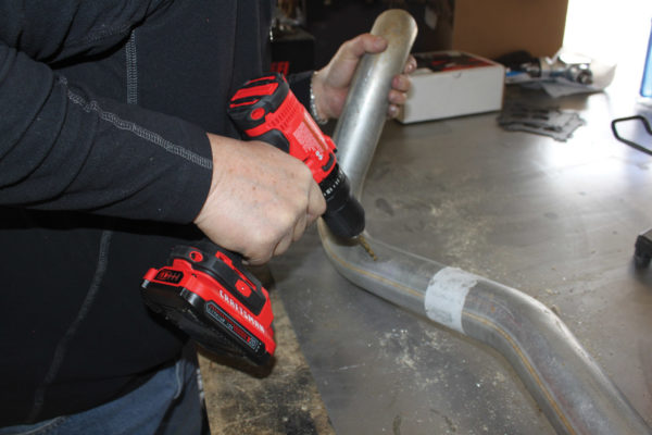 To accommodate the O2 sensor, drill a 3/4-inch hole in the exhaust pipe and ream it out.