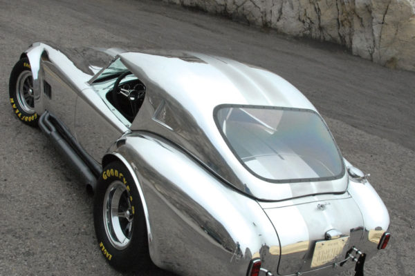 Look closely at the trunk lid, and you'll note that it's split, allowing access with the hardtop in place.