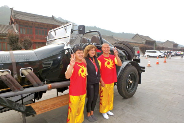 Katherine Trafton, Steve's wife and opilot/navigator of the No. 1 car, poses with some local Chinese dancers/singers.